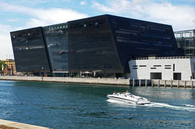 black huge building in front of water